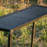 Industrial steel console table shown without corner brackets.