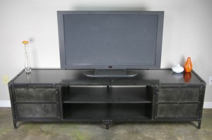 tv on top of rustic media console in Houston warehouse