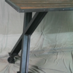Slanted x leg table
